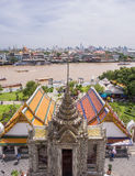 Dawn temple, landmark of Bangkok under cloudy blue sky Royalty Free Stock Photo
