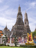 Dawn temple, landmark of Bangkok under cloudy blue sky Stock Photos