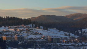 Dawn time lapse winter village. Time lapse shot at sunrise in winter village stock footage
