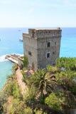 Dawn tower Torre aurora in Cinque Terre village Monterosso al Mare and Mediterranean Sea Royalty Free Stock Photography