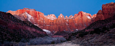 Dawn at Towers of the Virgin. Panoramic Composition of Snow Covered Towers of the Virgin at  Dawn In Zion National Park Royalty Free Stock Image