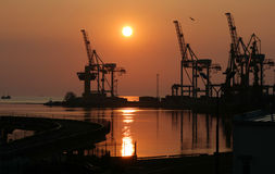 Dawn in trading port Stock Photos