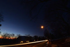 Dawn, with trees, stars, planets, car trails, NJ New Jersey. Stock Photography