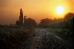Dawn in Tuscany with church.  Royalty Free Stock Image