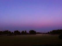 Dawn uit in het land Stock Afbeeldingen