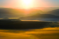 Dawn in the valley with the sun. Natural mountain landscape Stock Photo
