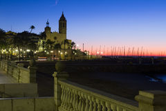 Dawn view of  church at embankment. Sitges Royalty Free Stock Photography
