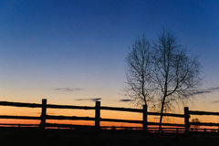 Dawn in the village fence. Morning in the village. Rustic fence at dawn Stock Photo