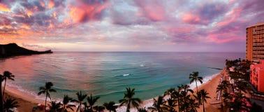 Dawn at Waikiki Beach. Waikiki Beach, Hawaii, as dawn lights up the clouds stock photography