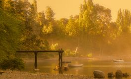 Pier on a lake a foggy day royalty free stock image