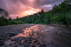 Dawning on mountain river Stock Image