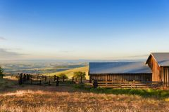 Golden Hour at The Dallas Mountain Ranch at Columbia Hills State. Dawns Light view of out buildings and vast landscape of The Dallas Mountain Ranch, a popular Stock Images