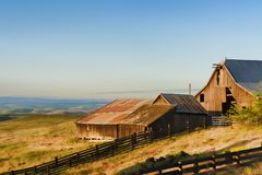 Golden Hour at The Dallas Mountain Ranch at Columbia Hills State. Dawns Light view of out buildings and vast landscape of The Dallas Mountain Ranch, a popular Stock Image