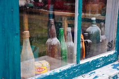 Old bottles in a window near Dawson City, Yukon. Dawson City is an eclectic and vibrant northern community on the banks of the Yukon River royalty free stock images