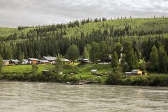 Dawson City:  A River View. This image was captured aboard a paddlewheel ship cruising the Yukon River at the outskirts of Dawson City, Yukon, Canada; July 25 Stock Image
