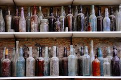 Old bottles in Dawson City, Yukon. Dawson City, Yukon is the heart of the world-famous Klondike Gold Rush stock photography