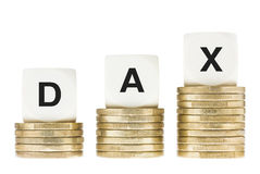 DAX (Frankfurt Stock Exchange Share Index) on Gold Coin Stacks Isolated on White Royalty Free Stock Photo