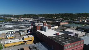 Day Aerial Establishing Shot of Pittsburgh's West End Industrial Park. 9315 A daytime aerial establishing shot of the various businesses and warehouses along the stock video