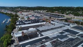 Day Aerial Establishing Shot of Pittsburgh's West End Industrial Park. 9319 A daytime aerial establishing shot of the various businesses and warehouses along the stock video
