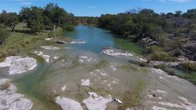 Day aerial flyover creek in Oklahoma