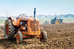 Day annual plowing with vintage tractors. VICENZA, ITALY - MARCH 20, 2016: Day annual plowing with antique tractors `Rosa` in Vicenza, Italy Stock Images
