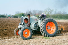 Day annual plowing with vintage tractors. VICENZA, ITALY - MARCH 20, 2016: Day annual plowing with antique tractors `Rosa` in Vicenza, Italy Royalty Free Stock Image