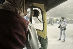 Day atmosphere in smog and taxi ride in Asia. Delhi, India - December 18, 2015: day atmosphere in smog and taxi ride in Asia Stock Photos
