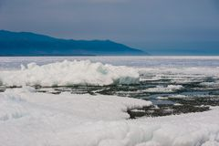 Day at Baikal Lake. Spring floating of ice Stock Photo