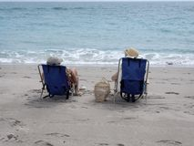 Day at the Beach. Two women sitting on the beach Stock Image