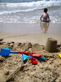 Day on the beach. Plastic toys on the sand Royalty Free Stock Photography