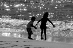 Day at The Beach. Children playing by the sea Stock Photography
