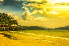 Day of beach with parachute in Langkawi. Malaysia. Sunny beach day and parachute in Langkawi. Malaysia stock image