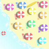 Parasols and bath towels at the beach as an illustration Stock Images