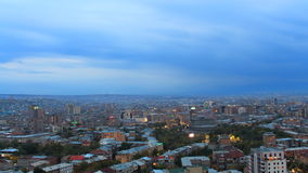 Day become night  over Yerevan cityscape. Timelapse stock video footage