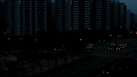 Day becomes night time lapse video of cars and traffic somewhere in East Singapore. Day becomes night time lapse video of cars and traffic somewhere in North stock footage