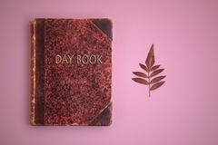 Day book pink background stock photography