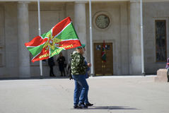 Day of the border guard celebration in Moscow. Men walk holding a flag Stock Image