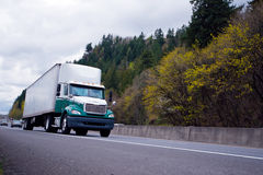 Day cab semi truck with aerodynamic spoiler and trailer on highw Royalty Free Stock Photos