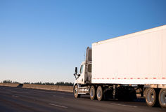Day cab semi truck with long trailer running on roadway Royalty Free Stock Photos