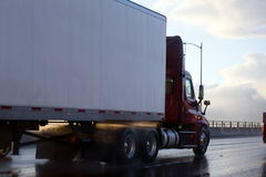 Day cab semi truck trailer in rain and sun reflection Royalty Free Stock Photos