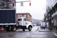 Day cab Semi truck trailer turn on urban city street Royalty Free Stock Photography