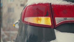Day. car Blinker light. emergency flashing lamp car during a snowfall 4k. Day. car Blinker light. emergency warning light of the car during snowfall. Accident stock footage
