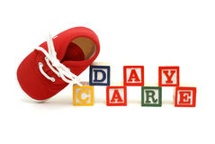 Day Care. An infants shoe next to the words day care Royalty Free Stock Images