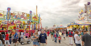 A Day at the Carnival. People wandering through amusement rides in Spin City, at the Wisconsin State Fair Royalty Free Stock Photography