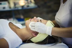 Day for cleanliness and beauty. Young women in spa center on face treatment. Close up. Copy space stock photo