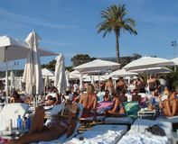 Day club in Ibiza. Tourists relaxing at a day club in Ibiza - Spain Royalty Free Stock Image