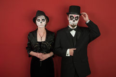 Day of the Dead. A classy couple with skeleton make up for Halloween or All Souls Day Stock Photo