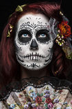 Day of the dead. A woman with her face painted as a traditional day of the dead sugarskull mask Royalty Free Stock Images