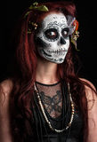Day of the dead. A woman with her face painted as a traditional day of the dead sugarskull mask Stock Photo