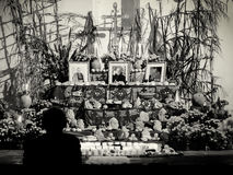 Day of the dead altar with pan de muerto and candles Stock Images